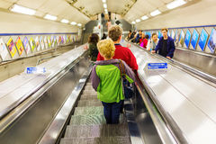 Busy commuters on elevators of an underground station in London, UK Royalty Free Stock Photos
