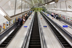 Busy commuters on elevators of an underground station in London, UK Royalty Free Stock Photography