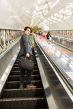 Busy commuters on elevators of an underground station in London, UK Stock Photography