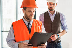 Busy concentrated foremen in room Royalty Free Stock Photography
