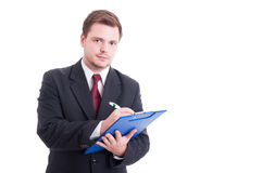 Busy and confident accountant writing on clipboard Stock Images