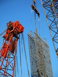 Busy Construction Site with Cranes Royalty Free Stock Photo