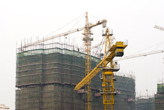 Busy construction site with Tower Cranes Stock Photography