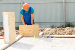 Busy Construction Worker Building House Royalty Free Stock Photography