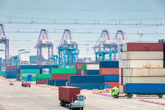 Busy container stack yard closeup. Modern logistics background Royalty Free Stock Photo
