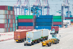 Busy container port closeup. Busy container terminal closeup, brisk trade and economic growth concept Stock Photos