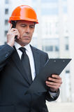 Busy contractor. Royalty Free Stock Image