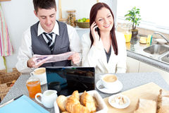 Busy couple of businesspeople having breakfast Royalty Free Stock Photo