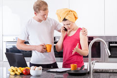Busy couple in the morning Stock Image
