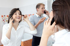 Busy couple in the morning. Busy couple during toilet in the morning Stock Image