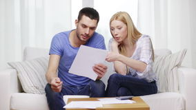 Busy couple with papers and calculator at home stock footage