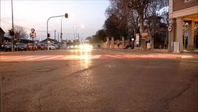 Busy crossroad in town in the evening stock video footage