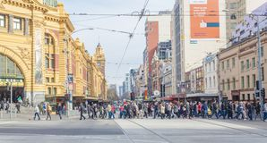 Busy crosswalk outside Flinders Street Station in Stock Photography