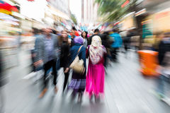 Busy crowd in the city with zoom effect Royalty Free Stock Photos