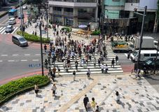 Busy Crowd Crossing Intersection Stock Photo