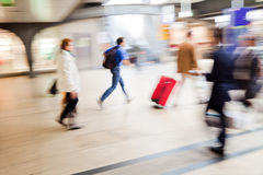 Busy crowd of people in motion blur Royalty Free Stock Image