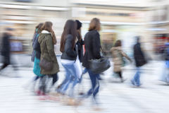 Busy crowd of people in motion blur Royalty Free Stock Images