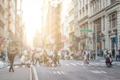 Busy crowds of people walk across the intersection in SoHo New York City. Busy crowds of people walk across the intersection of Broadway and Spring Street in the stock photography