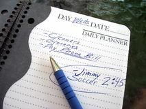 Busy day. A daily planner filled with a busy parent's daily activities Royalty Free Stock Photos