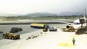 Busy day ground work in airport. Ground service work in airport Royalty Free Stock Image