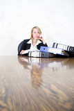 Busy day at the office. A busy woman at her desk Stock Photo
