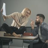 Busy day in office. Sensual woman and bearded man work together in office. Collaboration for success. Concentrated on Stock Photo