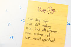 Busy day and plan on calendar. Stock Photos