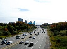 The picturesque Don Valley Parkway in Toronto in the fall. medium car traffic