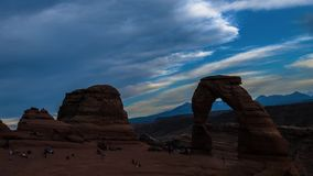 Busy Delicate Arch at Sunset Time lapse stock footage