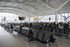 Busy departure gate at Heathrow airport stock images
