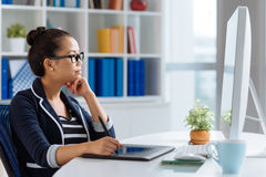 Busy designer. Graphic designer at her workplace, side view royalty free stock image