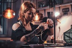 Attractive woman is working at creative glass workshop stock photos