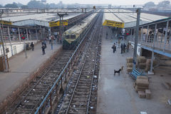 Busy and dirty train station in Agra, India. Transportation using trains in India is the cheapest option for locals. The trains are mostly reliable, but train Royalty Free Stock Image