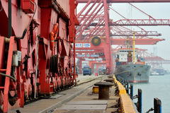 Busy dock area in Xiamen, Fujian, China. Xiamen harbor shipment and goods yard operation, in Fujian province, China, shown as working and operations in cargo Stock Photo