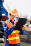 Busy dock worker. Dock worker busy with cargo distribution Stock Images