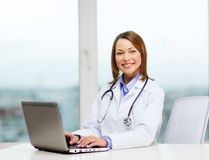 Busy doctor with laptop computer Stock Photo