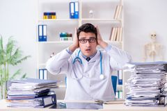 The busy doctor with too much work in hospital. Busy doctor with too much work in hospital Royalty Free Stock Image