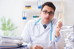 The busy doctor with too much work in hospital. Busy doctor with too much work in hospital Royalty Free Stock Photos