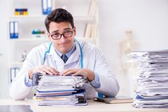 The busy doctor with too much work in hospital. Busy doctor with too much work in hospital Royalty Free Stock Photography