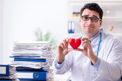 The busy doctor with too much work in hospital. Busy doctor with too much work in hospital Stock Images