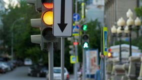 A busy downtown intersection. Traffic light, intersection, people. Royalty Free Stock Image