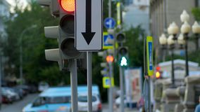 A busy downtown intersection. Traffic light, intersection, people. Royalty Free Stock Images