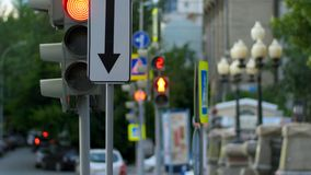 A busy downtown intersection. Traffic light, intersection, people. Stock Photo