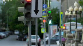 A busy downtown intersection. Traffic light, intersection, people. 4K stock footage