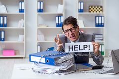 The busy employee chained to his office desk Stock Photography