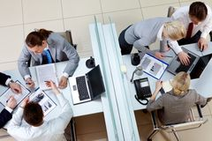 Busy employees. View from above of two business teams working separated by border in office Stock Photography
