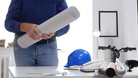 Busy engineer interior office close a building plan on the desk.  stock video footage
