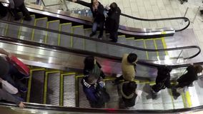 Busy escalators in Coquitlam center shopping mall stock video