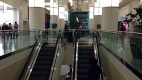 Busy escalators in Metropolis shopping mall Stock Images