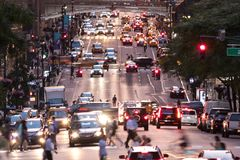 Busy evening cityscape with cars and people on 42nd Street in New York City Stock Image